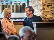12 SEPTEMBER 2019 - CLIVE, IOWA: Governor STEVE BULLOCK (D-MT), right, talks to CHRISTIE VILSACK, wife of former Iowa Gov. Tom Vilsack, before a campaign event in a microbrewery in Clive, IA, a suburb of Des Moines. Gov. Bullock is vying to be the Democratic party's nominee in 2020. He is campaigning in Iowa this week because he didn't qualify for the September 12 debate. Iowa traditionally hosts the the first election event of the presidential election cycle. The Iowa Caucuses will be on Feb. 3, 2020.                PHOTO BY JACK KURTZ