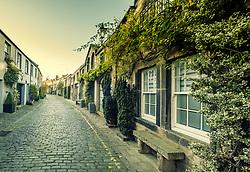 View along scenic traditional mews lane in Stockbridge district of New Town, Edinburgh, Scotland, United Kingdom