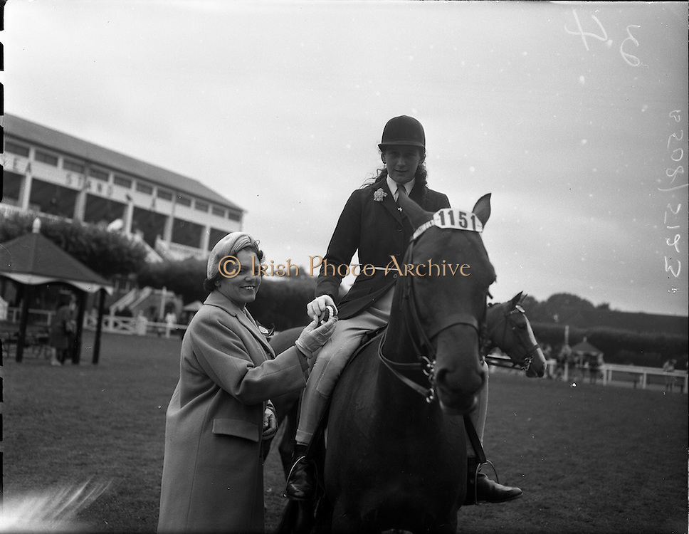 """03/08/1960<br /> 08/03/1960<br /> 03 August 1960<br /> R.D.S Horse Show Dublin (Wednesday). """"Crack-o-Dawn"""", owned and ridden by Miss Rosalyn Curran, Heathlands, Lisburn, Reserve Champion Childrens Pony and winner of Class 54 at the Dublin Horse Show."""