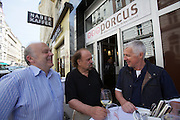 Vienna. Porcus altoesterreichische Schweinerei, a stylish fast food and take away specialized in traditional and exotic pork delikatessen. Owner/mastermind Ernst Prischl (r.) talking with guests.