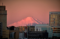 Dawn Alpine Glow over Mt. Fuji and Yokohama from my cabin on the MV World Odyssey. Image taken with a Fuji X-T1 camera and 55-200 mm OS lens (ISO 400, 55 mm, f/5.6, 1/250 sec).
