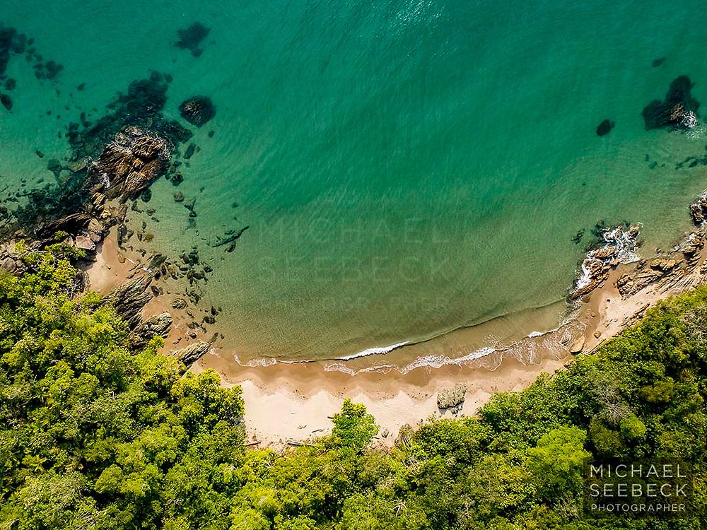 An aerial view of a secret beach on the Far North Queensland coastline.