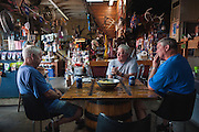 """Retirees Ron Reeves, left, Danny Reid, center and Jerry Thomas enjoy a beer together Monday June 10, 2013 at Karem's Bait and Beverage in Jeffersontown, Ky. """"We sit around talking about gardening, hunting and fishing,"""" Thomas explained. (Photo by Brian Bohannon/www.brianbohannon.com)"""