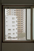 window view looking out on to residential high rise Yokosuka Japan