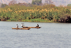 Men Fishing From Dugout Canoe On Shire River
