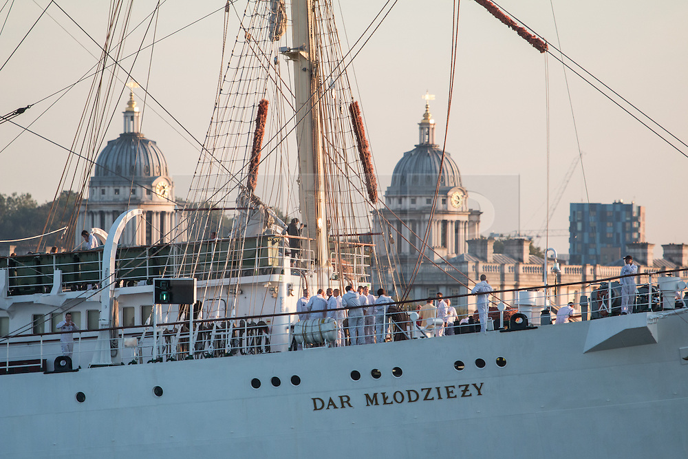 © Licensed to London News Pictures. 03/09/2014. The huge tall ship Dar Mlodziezy arrived in London the evening of September 3rd in readiness for this weekend's Royal Greenwich Tall Ships Festival. Reckoned to be the largest tall ship on the Thames for 25 years, the 108-metre-long Class A ship arrived in London shortly before sunset. She will be joined by approximately 50 other ships for the regatta this weekend which is expected to draw over a million people. All of the ships will leave in a Parade of Sail on September 9th. It is the biggest Tall Ships event on the Thames since the Tall Ships Race of 1989. Crew members have sailed the vessel from Falmouth to Greenwich. Credit : Rob Powell/LNP