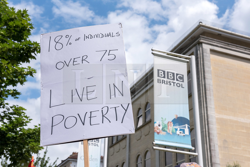 © Licensed to London News Pictures. 21/06/2019. Bristol, UK. BBC Licence Fee Protest, at the BBC Bristol offices on Whiteladies Road, to save the universal over 75s' free TV licence in the UK. The BBC has decided to introduce a means-test for licence fee payers where those who claim pensions' credit will be exempt from the TV licence charges, but 3.7 million pensioners will have to pay the annual licence fee of £154.50 from next year. In 2015, the Government passed responsibility for the free TV licence for the over-75s to the BBC, and said they would cease to fund the free licence from 2020. Protests across the UK have been called by the National Pensioners Convention who are fighting the proposal to end the current arrangement, and are asking for responsibility for what they say is a vital welfare benefit for over-75s to be taken back under government control. Photo credit: Simon Chapman/LNP.