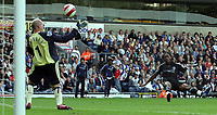 Photo: Paul Thomas.<br /> Blackburn Rovers v Chelsea. The Barclays Premiership. 27/08/2006.<br /> <br /> Didier Drogba of Chelsea (R) scores past Blackburn keeper Brad Friedel (Yellow).
