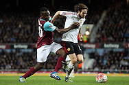 Daley Blind of Manchester United goes past Michail Antonio of West Ham United. The Emirates FA cup, 6th round replay match, West Ham Utd v Manchester Utd at the Boleyn Ground, Upton Park  in London on Wednesday 13th April 2016.<br /> pic by John Patrick Fletcher, Andrew Orchard sports photography.