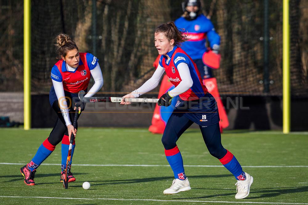 BILTHOVEN -  Hoofdklasse competitiewedstrijd dames, SCHC v hdm, seizoen 2020-2021.<br /> Foto: Suzanne Homma (SCHC) en Fabiënne Roosen (SCHC)