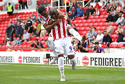 Stoke City's Benik Afobe (bottom) celebrates scoring his side's first goal of the game with Tom Ince