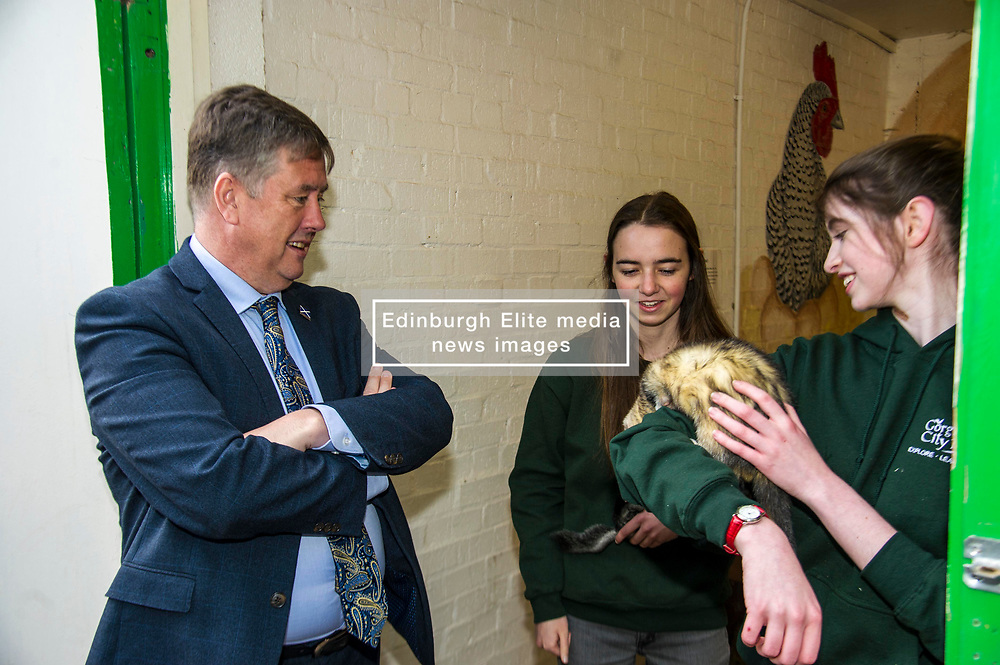 Pictured: Kieth Brown meets Zoe White holding Zak rgw Chinchilla and Kirsty McGoff holding Edgar the Ferre<br /> <br /> Cabinet Secretary for Economy, Jobs & Fair Work Keith Brown visited Gorgie City Farm today  to mark their accreditation as the 800th Living Wage employer in Scotland. Mr Brown met Josiah Lockhart, CEO and undertook a short tour of the farm, celebrating their accreditation and promoting the Living Wage more generally. The Scottish Government has set a target of reaching 1,000 Scottish-based Living Wage Accredited Employers by autumn 2017. While at the farm Mr Brown met Maia Gordon, Kirsty McGoff (17) and Zoe White (18), who have benefited from the living wage, and George Ellis, chair of the farm's board of directors<br /> Ger Harley | EEm 18 May 2017