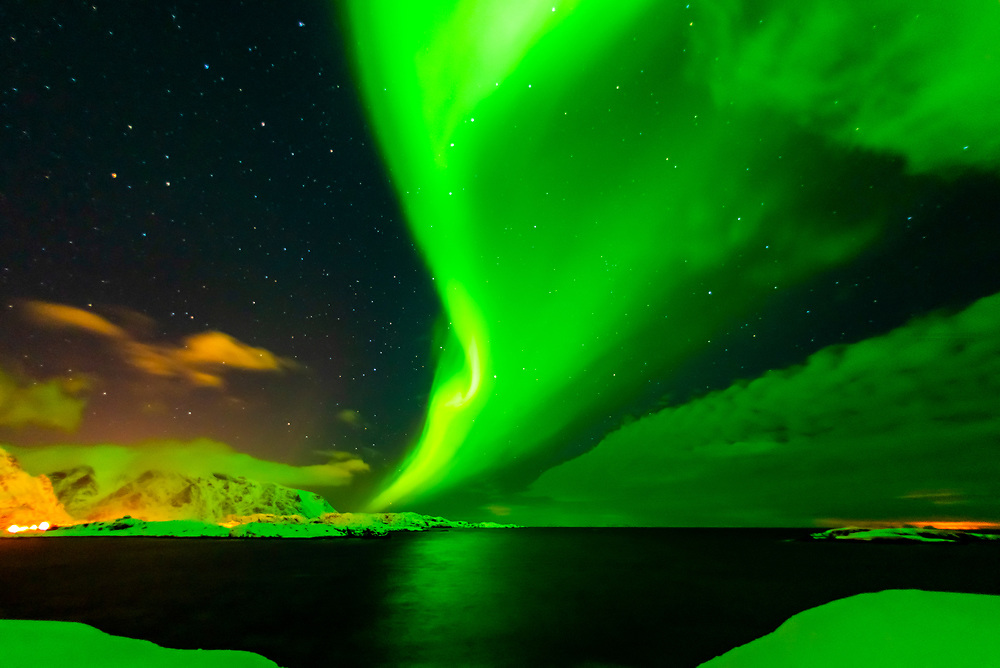 Dancing Northern Lights (Aurora Borealis) seen from along the E10 near Reine, Moskenoesoya Island, Lofoten Islands, Arctic, Northern Norway.