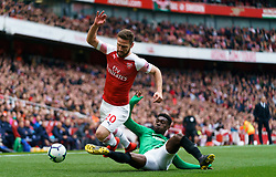 Arsenal's Shkodran Mustafi, (left) is tackled by Brighton and Hove Albion's Yves Bissouma (right) during the Premier League match at the Emirates Stadium, London.