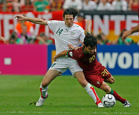 Photo: Glyn Thomas.<br />Portugal v Iran. Group D, FIFA World Cup 2006. 17/06/2006.<br /> Portugal's Deco (R) and Iran's Andranik Teymourian.