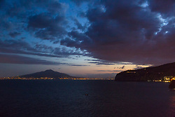 Sorrento, Italy, September 13 2017. Mt Versuvio and the lights of Naples in the distance across the Bay of Naples, night becomes day, photographed on an early morning walkabout in Sorrento, Italy. © Paul Davey