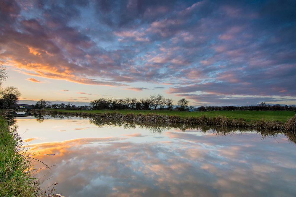 The sun setting over a canal in rural Leicestershire.