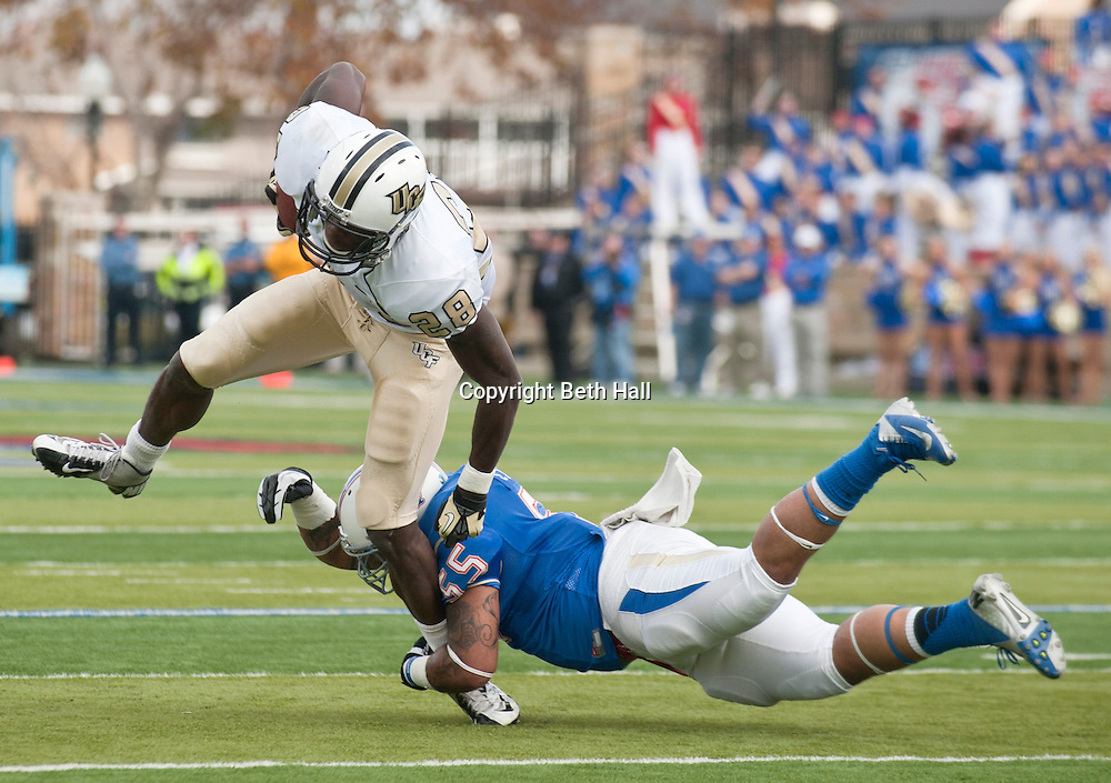 Dec 1, 2012; Tulsa, Ok, USA; University of Central Florida Knights running back Latavius Murray (28) is bought down by linebacker Shawn Jackson (55) during a game at Skelly Field at H.A. Chapman Stadium. Tulsa defeated UCF 33-27 in overtime to win the CUSA Championship. Mandatory Credit: Beth Hall-US PRESSWIRE