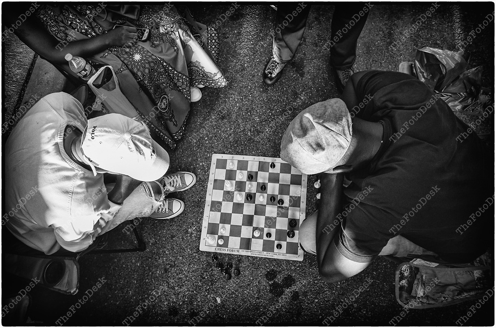 NEWARK, NEW JERSEY: Men play a game of chess while attending the weekly Block Party on Edison Plaice in Newark, NJ on Friday, July 30, 2021 (Brian B Price/TheFotodesk).