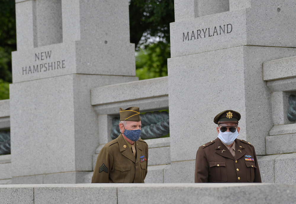 5/25/20 9:17:01 AM -- Washington, DC, U.S.A  -- Sidney Wade, left, and Patrick McCourt, both are living history volunteer WWII re-enactors, taking part during a wreath laying ceremony at the National WWII Memorial on Memorial Day, Monday, May 25, 2020. -- Photo by Jack Gruber, USA TODAY Staff
