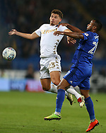 Kalvin Phillips of Leeds Utd (l) jumps to win the ball from Loic Damour of Cardiff city ®. EFL Skybet championship match, Cardiff city v Leeds Utd at the Cardiff city stadium in Cardiff, South Wales on Tuesday 26th September 2017.<br /> pic by Andrew Orchard, Andrew Orchard sports photography.
