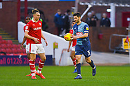 Joe Jacobson of Wycombe Wanderers (3) takes the ball back to the centre circle after scoring a late penalty to make the score 2-1 during the EFL Sky Bet League 1 match between Barnsley and Wycombe Wanderers at Oakwell, Barnsley, England on 16 February 2019.