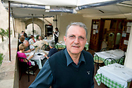 Eustachio  Persia, fouder and owner of Terrazzino Restaurant, portayed in the exteral side of his restaurant