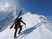 A ski mountaineer ascends Valhala Peak, Chugach Mountains, Alaska