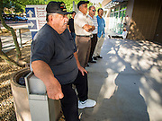 01 OCTOBER 2013 - PHOENIX, AZ:   A man waits in line to get into the Social Security Administration offices in Phoenix Tuesday on the first day of the partial shut down of the government. The US government closed most non-essential federal services Tuesday. The shutdown is be the first in the US in 17 years. More than 700,000 federal government workers could be sent home on unpaid leave, with no guarantee of back pay once the deadlock is over.   PHOTO BY JACK KURTZ
