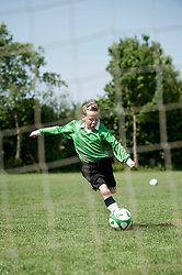Young boy soccer penalty practice football ball