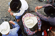 24 FEBRUARY 2002, TUCSON, ARIZONA, USA: Cowboys relax behind the bucking chutes at the Fiesta de los Vaqueros Rodeo in Tucson, Az, Sunday, Feb. 24, 2002. The Fiesta de los Vaqueros Rodeo has been held for 77 years and is one of the largest professional rodeos in the US..PHOTO BY JACK KURTZ