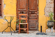 A cafe table sits empty after hours in Chania Crete.