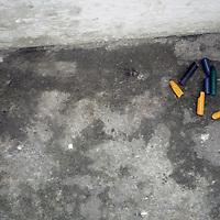 South America, Brazil. Rio de Janiero. Broken crayons on street of Vila Canoas favela.