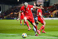 Wales defender Paul Dummett shields the ball from Trinidad and Tobago midfielder Levi Garcia during the Friendly European Championship warm up match between Wales and Trinidad and Tobago at the Racecourse Ground, Wrexham, United Kingdom on 20 March 2019.