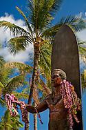 Flower Leis on statue of Duke Kahanamoku statue, Kuhio Beach Park, Waikiki Beach, Honolulu, Oahu, Hawaii