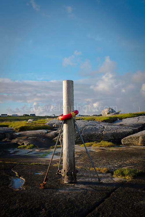 "Life ring near the crossing to Omey Island, Connemara, Galway, Ireland. Omey is a tidal island - with a signposted route so that can cars can drive out on the sand during low tide. This mage can be licensed via Millennium Images. Contact me for more details, or email mail@milim.com For prints, contact me, or click ""add to cart"" to some standard print options."