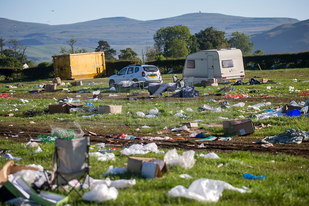 © Licensed to London News Pictures. 10/06/2019. Appleby UK. Fields have been left covered in rubbish this morning by Travellers leaving the Appleby Horse Fair in Cumbria. Appleby Horse Fair attracts around 10,000 Gypsies & Travellers & is thought to be the largest Gypsy Fair in Europe. Photo credit: Andrew McCaren/LNP