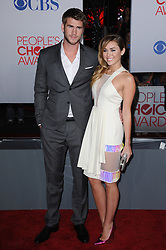 Liam Hemsworth and Miley Cyrus arrive at the 38th Annual People's Choice Awards held at the Nokia Theatre in Los Angeles, Ca, USA, January 11th, 2012. Photo by Lionel Hahn/ABACAPRESS.COM
