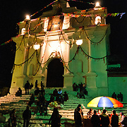 People gathering in front of Santo Tomas Church at night before the market. Chichicastenango is an indigenous Maya town in the Guatemalan highlands about 90 miles northwest of Guatemala City and at an elevation of nearly 6,500 feet. It is most famous for its markets on Sundays and Thursdays.