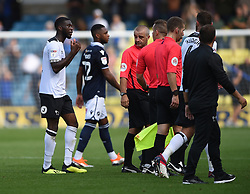 Derby County's Fikayo Tomori talks to the officials at full time