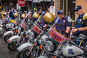 State police, complete with beads waiting for any trouble during Mardi Gras on 25th February 2020 in New Orleans, Louisiana, United States. Mardi Gras is the biggest celebration the city of New Orleans hosts every year. The magnificent, costumed, beaded and feathered party is laced with tradition and  having a good time. Celebrations are concentrated for about two weeks before and culminate on Fat Tuesday the day before Ash Wednesday and Lent.