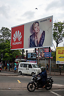 A billboard advertising the Huawei P9 smart phone and featuring Scarlett Johansson rises above a street in Colombo, Sri Lanka (March 31, 2017)