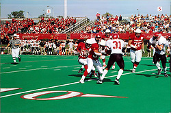 September 22, 2001:  Illinois State Redbirds Football, Willie Watts gets block on Issac Huddleston from a Redbird linesman..This image was scanned from a print.  Image quality may vary.  Dust and other unwanted artifacts may exist.
