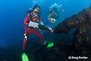 diver Bud Turpin shapes erupting pillow lava by hand to form underwater lava sculptures at ocean entry from Kilauea Volcano, Hawaii Island ( the Big Island ), Hawaii, U.S.A. ( Central Pacific Ocean ) MR 381, 382