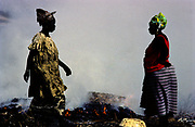 Kayar, a fishing town 60km from Dakar. Women smoking fish. Fishing has sustained generations of people, but the industry that has kept the town afloat for countless years is in danger of sinking. atches are dramatically down.