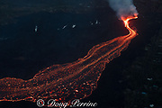 lava erupting from fissure 8 of the Kilauea Volcano east rift zone in Leilani Estates subdivision, near Pahoa, flows downslope at dusk as a glowing river of hot lava toward Kapoho, lower Puna District, Hawaii Island ( the Big Island ), Hawaiian Islands, U.S.A. ( Pacific Ocean )
