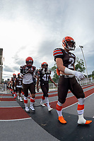 KELOWNA, BC - AUGUST 17:  Garret CAPE #2, Nate Adams #41 and Michael Guirestante #36 of Okanagan Sun walk to the field against the Westshore Rebels  at the Apple Bowl on August 17, 2019 in Kelowna, Canada. (Photo by Marissa Baecker/Shoot the Breeze)