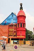 CHONGQING, CHINA - AUGUST 02: (CHINA OUT) <br /> <br /> Fire Extinguisher Shaped Building<br /> <br /> A 6-stair fire extinguisher shaped building with the height of 18 meters is seen on August 2, 2014 in Chongqing, China. A 6-stair fire extinguisher shaped firefighting experience pavilion with the height of 18 meters was under construction in Chongqing<br /> ©Exclusivepix