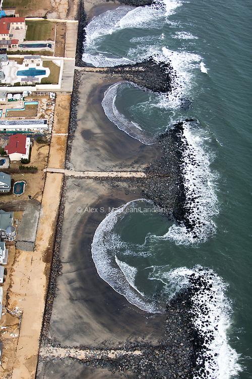 Shoreline pools between jetties.