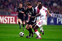Fotball. UEFA Champions League. 22.10.2002.<br />Ajax v Rosenborg.<br />Harald Martin Brattbakk og Hatem Trabelsi.<br />Foto: Jasper Ruhe, Digitalsport